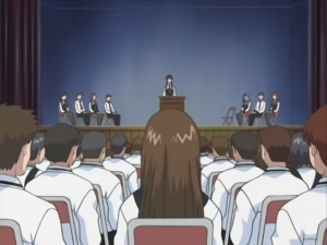 Shot S2E1 school assembly.png