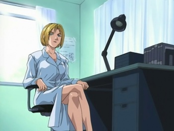 Shot S1E1 kitami at desk.jpg